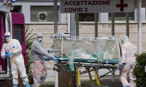 A patient in a biocontainment unit is transferred from an ambulance into Columbus Covid 2 hospital in Rome.