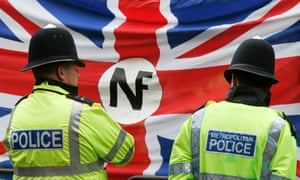 Police watch a demonstration by the far-right National Front in London