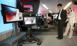 Fardad Farahzad, a presenter for BBC Persian, prepares to read the news