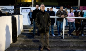 Ken Loach standing on the terraces of Bath City football club.