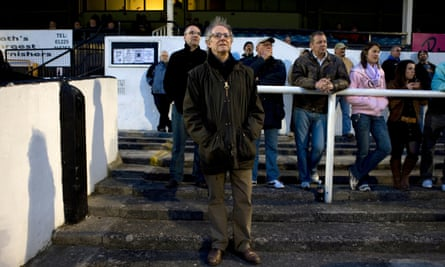 Ken Loach standing on the terraces of Bath City football club.