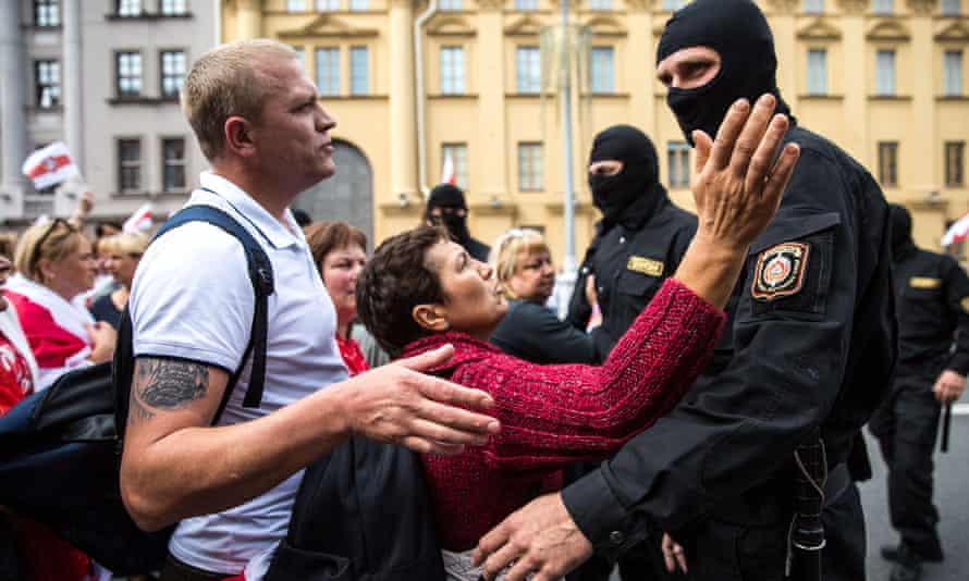 Protesters speak with Belarusian security forces during protests in Minsk on Sunday.