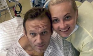 Alexei Navalny and his wife, Yulia, posing for a photo in a hospital in Berlin, Germany