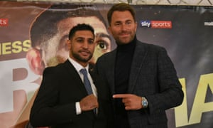 Amir Khan will return to the ring after a near two-year absence at Liverpool's Echo Arena on 21 April after signing a three-fight contract with Eddie Hearn.