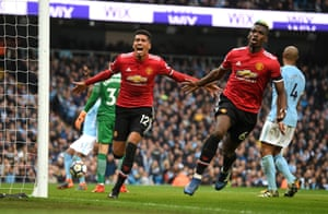 Chris Smalling (left) and Paul Pogba (right) celebrate scoring