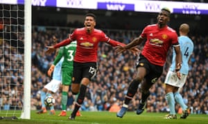 Manchester United's Chris Smalling celebrates scoring his side's third goal with Paul Pogba.