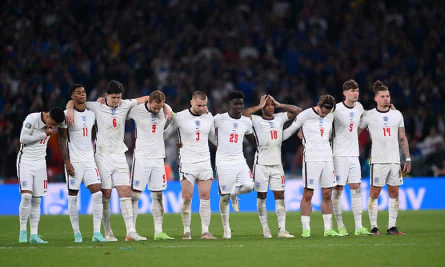 The England team look on during the penalty shootout at the Euro 2020 final.
