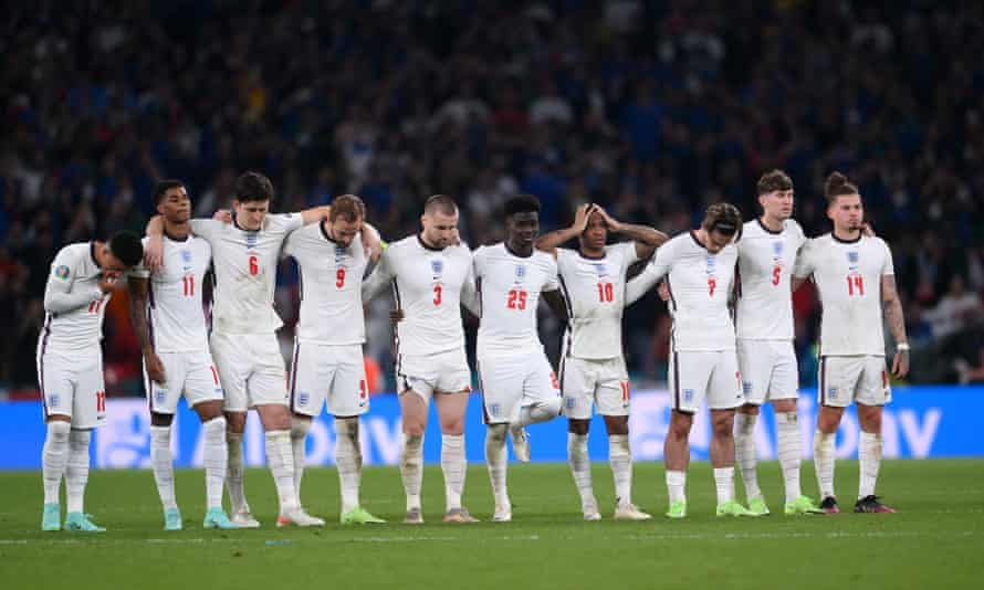 The England players look on during the penalty shootout for Euro 2020