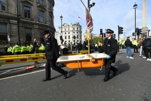 London, England Police remove a bathtub from Trafalgar Square during an Extinction Rebellion protest