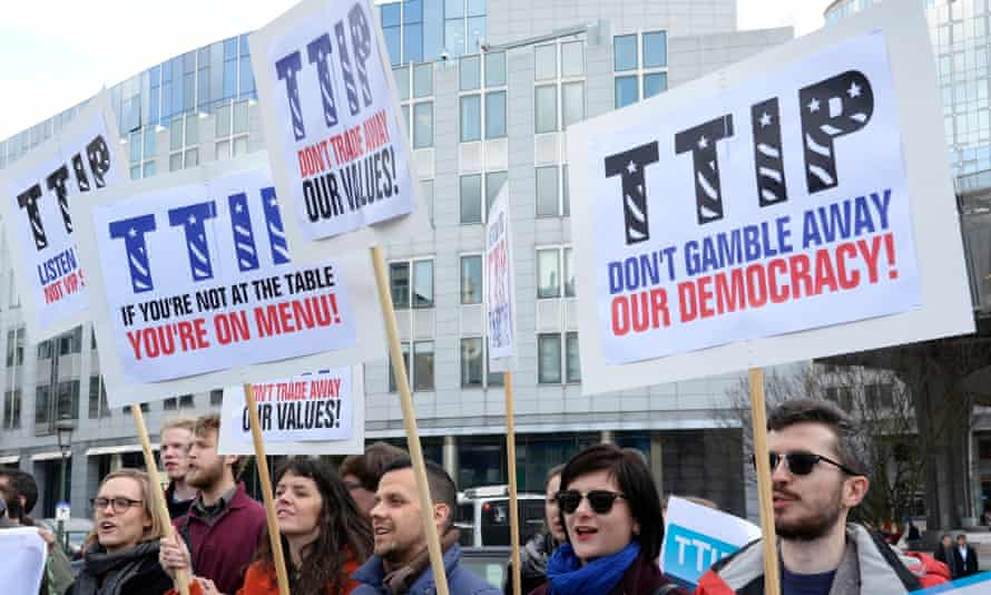 People protest against the Transatlantic Trade and Investment Partnership (TTIP) between the EU and US outside the European parliament in Brussels