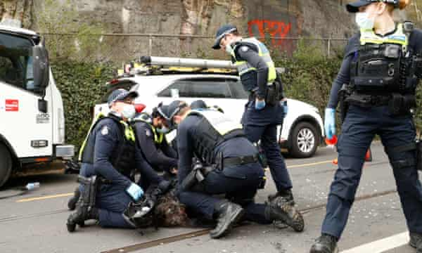 A man is arrested by police on Victoria Street, Richmond.