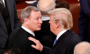 Trump with chief justice Roberts after his State of the Union address in January.
