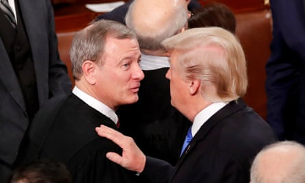 Donald Trump talks with John Roberts after his State of the Union address in January.