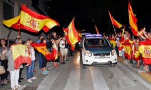 Guardia Civil officers are cheered by locals as they head to Catalonia