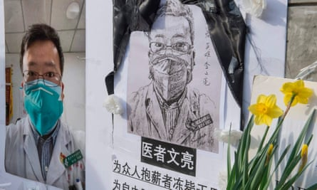 A memorial for Dr Li Wenliang, a whistleblower in Wuhan who died of the coronavirus after being investigated for spreading 'false rumours'.