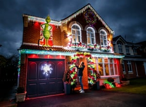 Paul Fenning puts the finishing touches to the decorations on his home in Doncaster, South Yorkshire