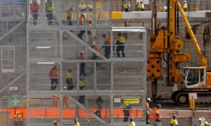 Construction workers descend using temporary stairs on a major construction site in central Sydney June 13, 2013.
