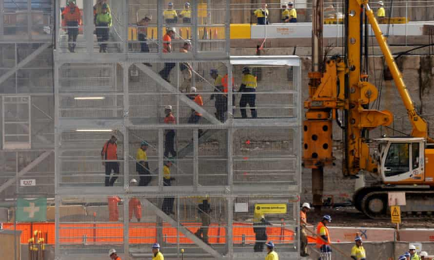 Construction workers descend using temporary stairs on a construction site in central Sydney 13 June 2013.