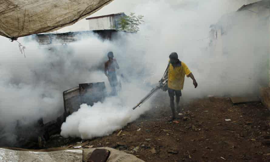 A Sri Lankan worker fumigates buildings to control mosquitoes in Colombo.