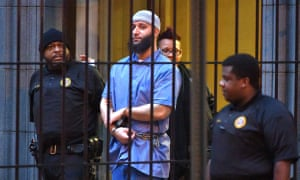 'We're still procession it' … Adnan Syed is led from the Baltimore appeals courthouse after a hearing.