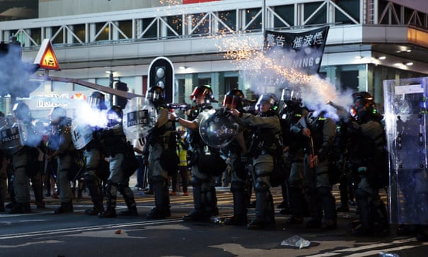 'More than half of Hong Kongers have zero trust in the police.' Riot officers fire teargas during a rally against police brutality on Sunday.