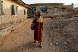 Ajayi walks through her neighbourhood as she makes her way to school