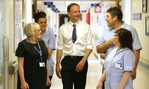 Simon Stevens (centre) is talking to staff at at Shotley Bridge hospital in County Durham.
