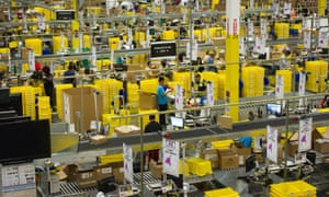 Employees pack items to be shipped from the Amazon distribution centre in Phoenix, Arizona.