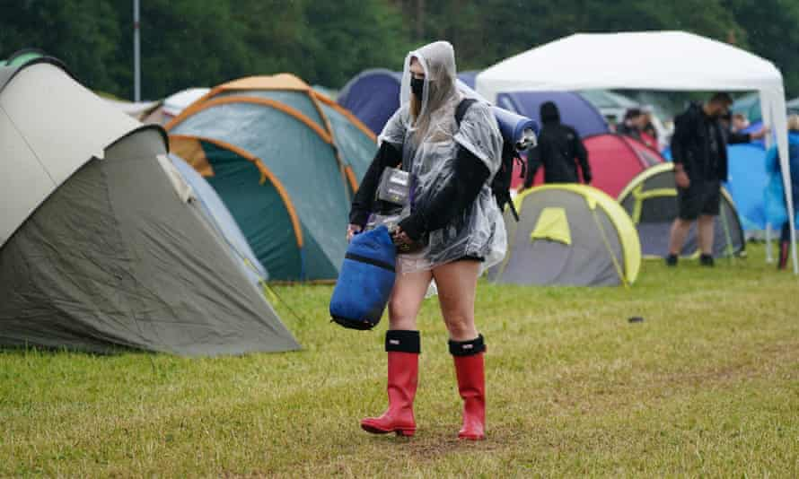 A festivalgoer arrives on the first day of Download Festival at Donington Park/