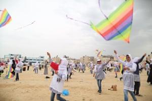 Girls flying kites