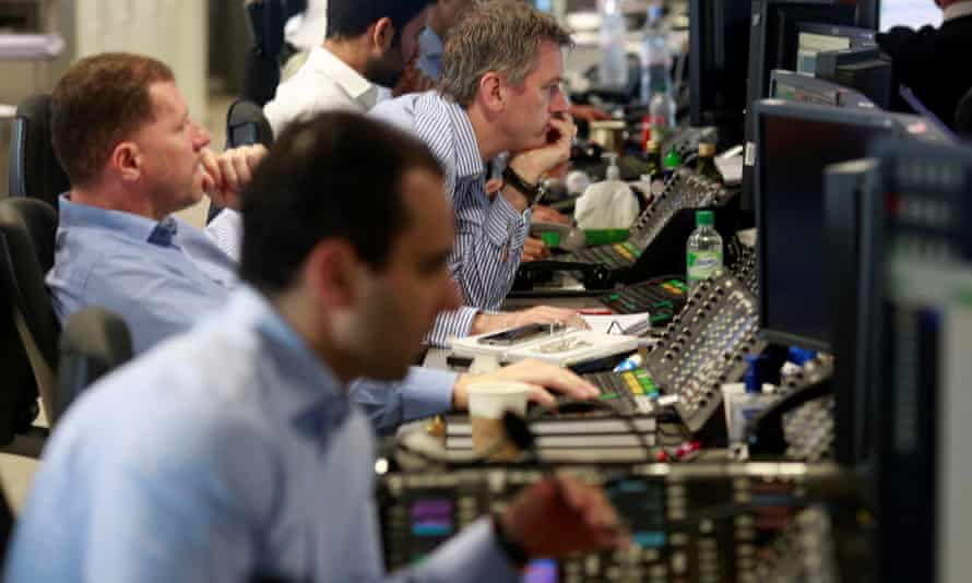 Traders from BGC Partners in London's Canary Wharf