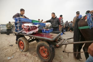 Crew members load the carts for Gaza city