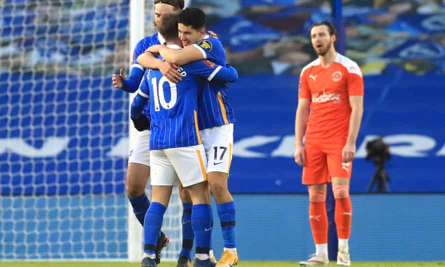 Steven Alzate is congratulated by Alexis Mac Allister to celebrate scoring Brighton's second goal against Blackpool.