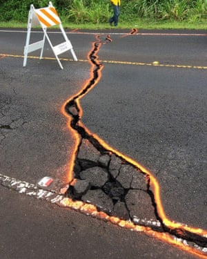 Ground cracking extends across Highway 130 in Puna, Hawaii.