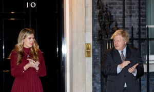 Boris Johnson and his partner Carrie Symonds taking part in the national clap for late Captain Sir Tom Moore this evening.