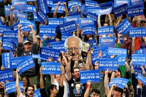Students and supporters of Bernie Sanders cheer and hold up signs during a campaign rally at Colorado State University in Fort Collins, Colorado.