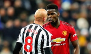 Paul Pogba reacts after a challenge from Jonjo Shelvey. The Frenchman was injured by the tackle but the Newcastle midfielder went unpunished.