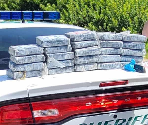 packages piled on sheriff's car