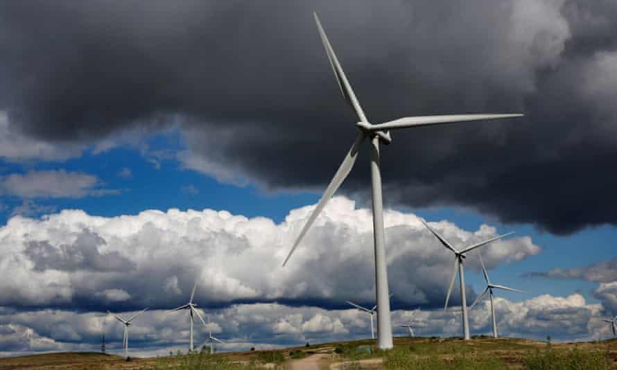 a dark stormy cloud over a windfarm