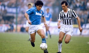 Diego Maradona in action for Napoli taking on Luigi De Agostini of Juventus in 1988.