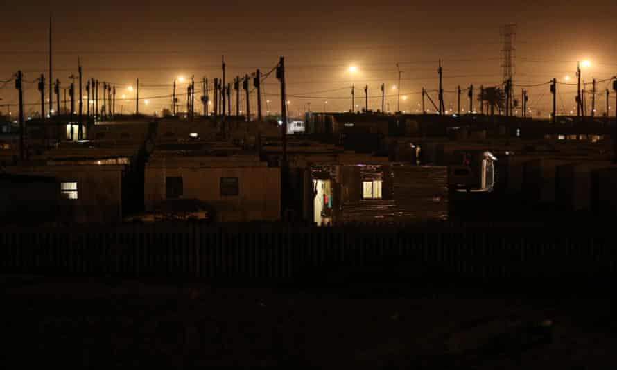 Overhead power lines are seen at Khayelitsha informal housing settlement near Cape Town