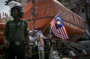 Bangladeshi police guard Chittagong port as the aid ship arrives