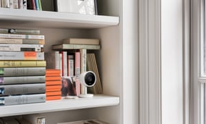 The Nest Cam IQ hidden amongst some books.