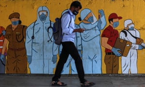 An Indian man walks past a wall showing a graffiti honoring frontline workers in the fight against the spread of coronavirus COVID-19, in Mumbai, India, 17 March 2021. India reported 35,871 new coronavirus cases on Thursday, the highest in more than three months, with the worst-affected state of Maharashtra alone accounting for 65% of that.
