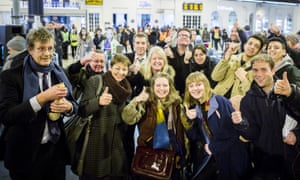 """David Boyle, left, and other """"striking"""" passengers at Brighton station."""