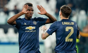 Paul Pogba celebrates Manchester United's win at Juventus with Victor Lindelöf.