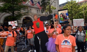 Immigrants and supporters demonstrate during a rally in support of Daca in front of the Trump International Hotel in Washington DC in September 2017.