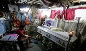 Kimberly Sailog, mourns her 12-year-old daughter Kristine, who was killed by a stray bullet in a church car park.