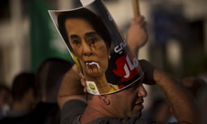 A defaced poster of Aung San Suu Kyi during a demonstration to condemn Myanmar's treatment of the Rohingya.