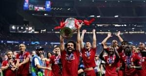Goalscorer Mohamed Salah shows off the trophy to the Liverpool fans